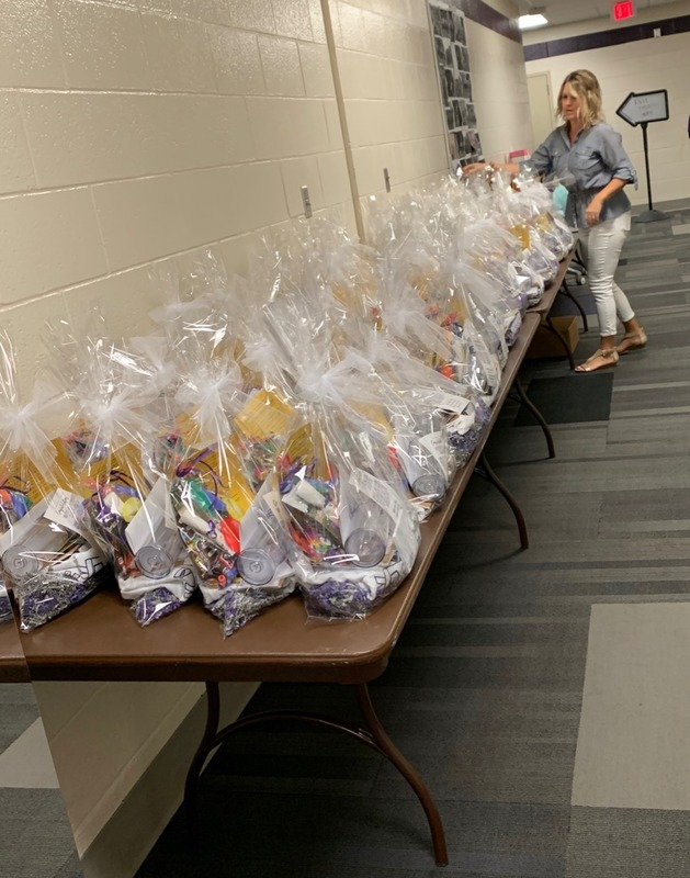 Volunteer preparing alumni starter kits for seniors